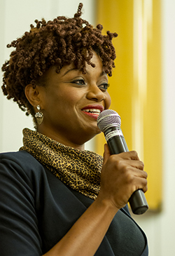 Patrice Juah with microphone.