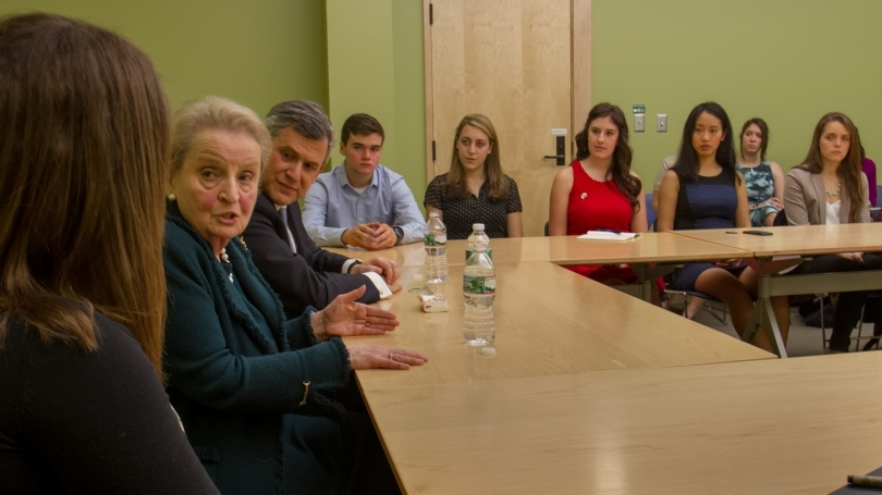 Students participate in a discussion with former Secretary of State Madeleine Albright.
