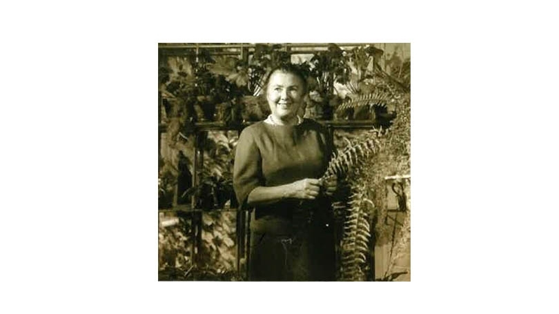 Christine Dickey poses with plants.