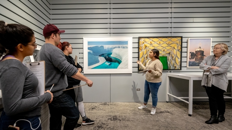 A student presents her artwork to fellow students at the HOOD Museum of Art.