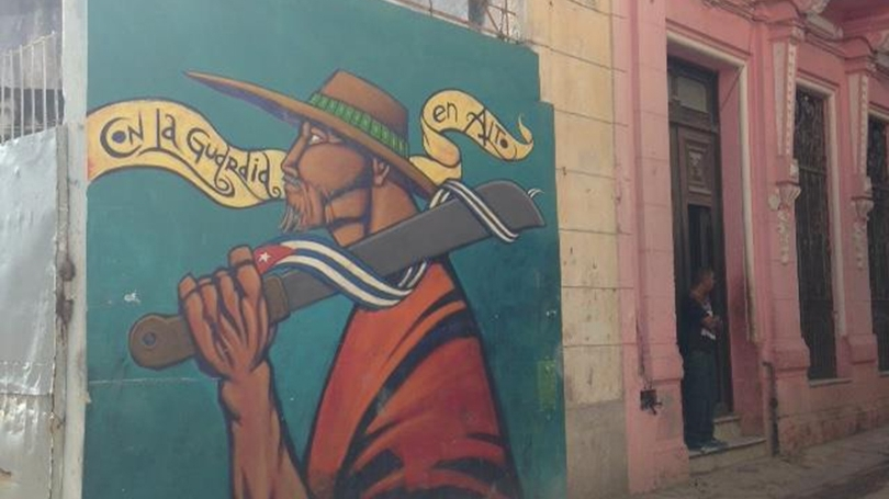 Street art in Centro Habana celebrating the labor of the Committees for the Defense of the Revolution.